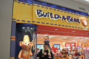Man and child outside Build A Bear Workshop